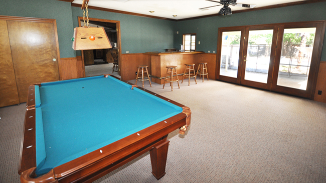 Game room features a full Oak wet bar